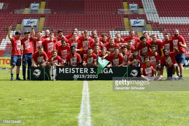 The team of FC Bayern Muenchen II celebrates the championship following the 3. Liga match between 1. FC Kaiserslautern and Bayern Muenchen II at...