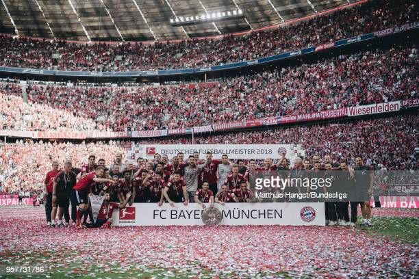 The team of FC Bayern Muenchen poses for a teamphoto with the trophy Meisterschale after the Bundesliga match between FC Bayern Muenchen and VfB...