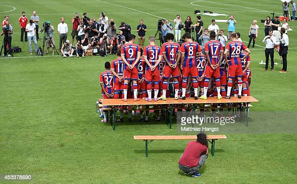 The team of FC Bayern Muenchen prepares for the official team photo during the FC Bayern Muenchen Team Presentation at Saebener Strasse on August 9,...