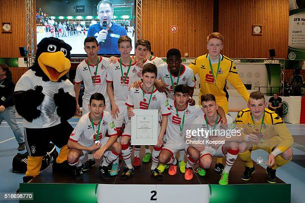 The team of FC Koeln poses on the podium after winning the second place of the during the DFB B Junior Indoor Cup at Sporthalle West on March 20 2016...