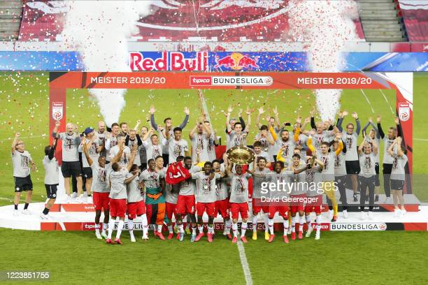 the team of FC Red Bull Salzburg celebrates winning the austrian soccer championships 19/20 prior the tipico Bundesliga match between Red Bull...