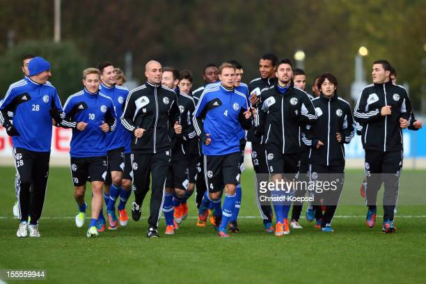 The team of FC Schalke 04 attends a training session at their training ground ahead of the UEFA Champions League group B match between FC Schalke 04...