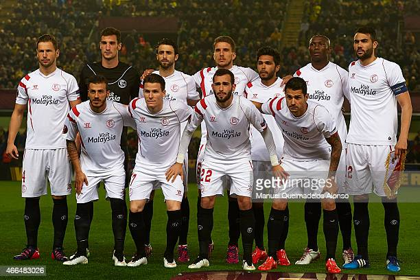 The team of FC Sevilla lines up before the UEFA Europa League round of 16 match between Villarreal and FC Sevilla at Estadio El Madrigal on March 12...