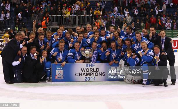 The team of Finland pose for a photo after winning the IIHF World Championship gold medal match between Sweden and Finland at Orange Arena on May 15,...