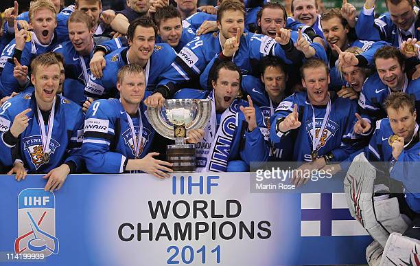 The team of Finland pose for a photo after winning the IIHF World Championship gold medal match between Sweden and Finland at Orange Arena on May 15...