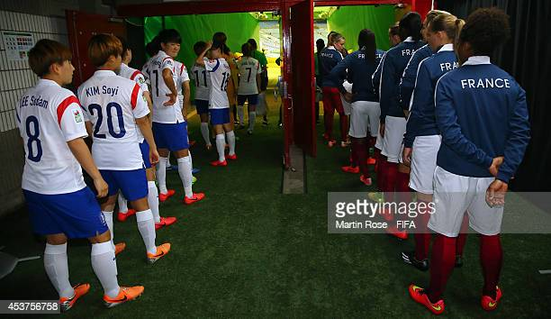 The team of France and Korea Republic line up in the players tunnel before the FIFA U20 Women's World Cup 2014 quater final match between France and...