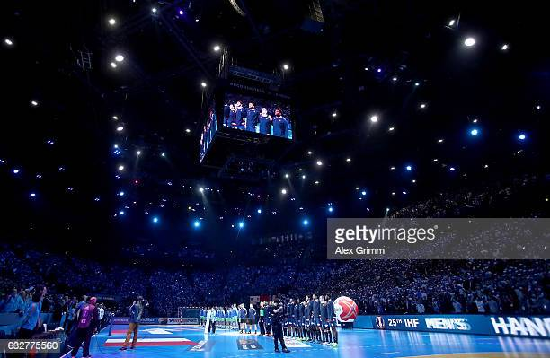The team of France and of of Slovenia line up before the 25th IHF Men's World Championship 2017 Semi Final match between France and Slovenia at...