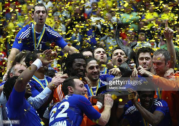 The team of France celebrate with the trophy after winning the Men's Handball World Championship final match between France and Danmark at Malmo...