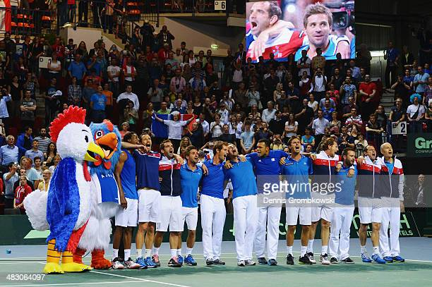 The team of France celebrates singing their national anthem after day 3 of the Davis Cup Quarter Final match between France and Germany on April 6...