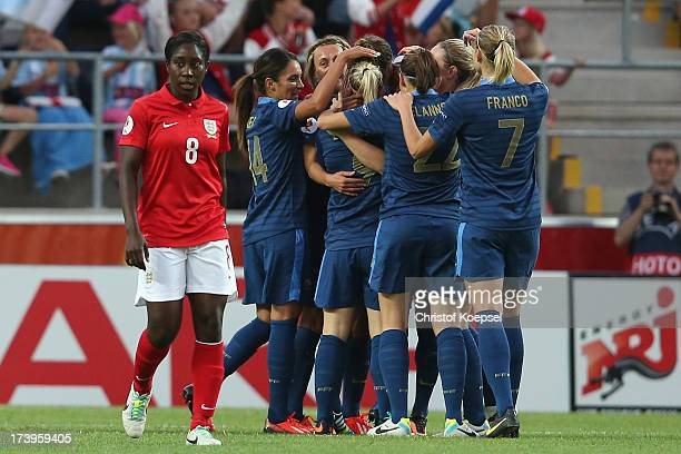 The team of France celebrates the first goal of Eugenie Le Sommer and Anita Asante of England looks dejected during the UEFA Women's EURO 2013 Group...