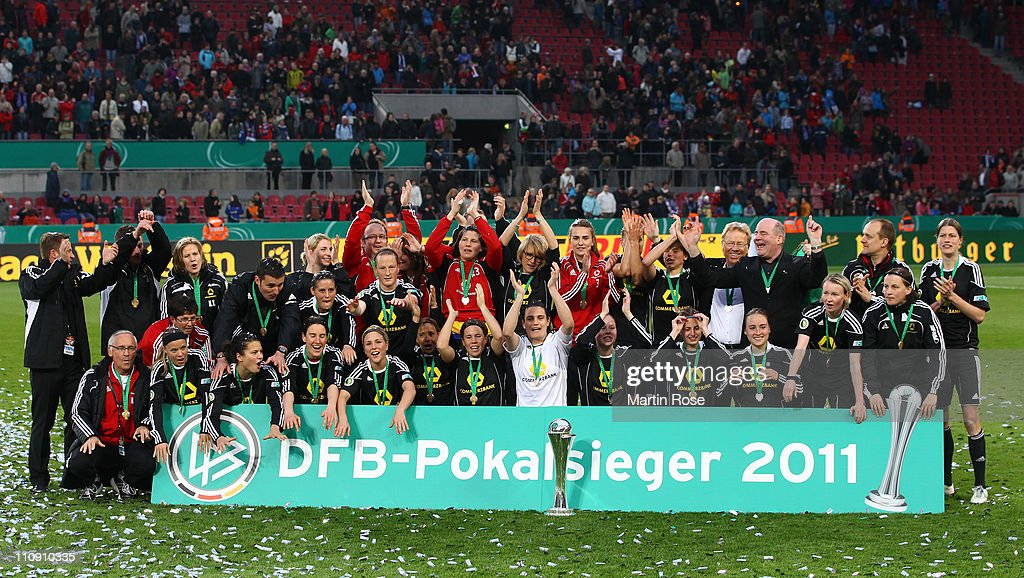 The team of Frankfurt celebrate after wiining the DFB Women's Cup final match between 1. FFC Frankfurt and Turbine Potsdam at RheinEnergie stadium on March 26, 2011 in Cologne, Germany.