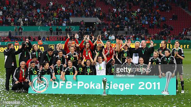 The team of Frankfurt celebrate after wiining the DFB Women's Cup final match between 1 FFC Frankfurt and Turbine Potsdam at RheinEnergie stadium on...