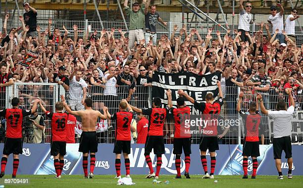 The team of Frankfurt celebrate with the fans after the Bundesliga match between Werder Bremen and Eintracht Frankfurt at the Weser stadium on August...