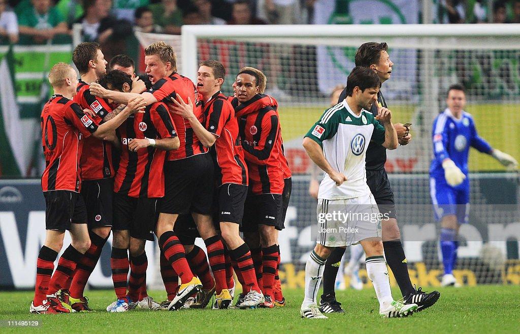 The team of Frankfurt celebrates after Alexander Meier scored his team's first goal during the Bundesliga match between VfL Wolfsburg and Eintracht Frankfurt at Volkswagen Arena on April 3, 2011 in Wolfsburg, Germany.