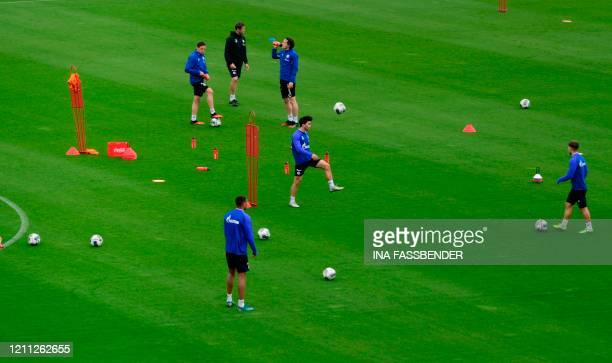 The team of German Bundesliga club FC Schalke 04 attends a training session at the club's training grounds in Gelsenkirchen, western Germany on April...