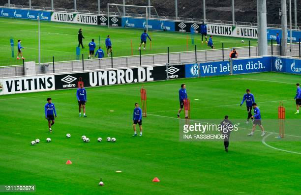 The team of German Bundesliga club FC Schalke 04 attends a training session at the club's training grounds in Gelsenkirchen western Germany on April...