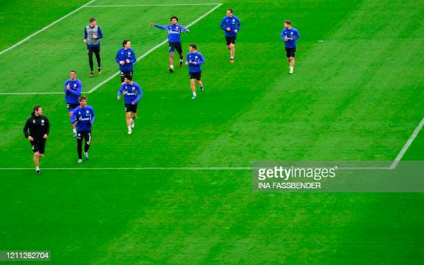 The team of German Bundesliga club FC Schalke 04 warms up during a training session at the club's training grounds in Gelsenkirchen, western Germany...