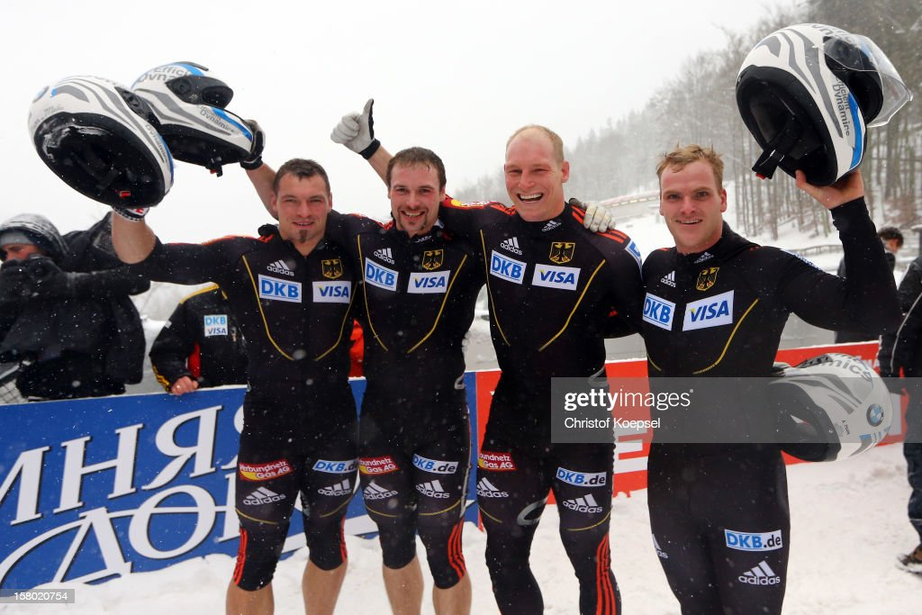The team of Germany 3 celebrates their third place with Martin Putze, Alexander Roediger, Alex Mann and Maximilian Arndt after the four men's bob competition during the FIBT Bob & Skeleton World Cup at Bobbahn Winterberg on December 9, 2012 in Winterberg, Germany.