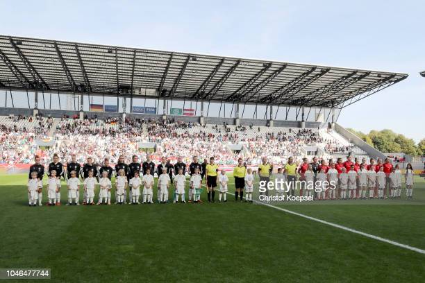 The team of Germany and Austria stands for the national anthem prior to the International friendly match between Germany Women and Austria Women at...