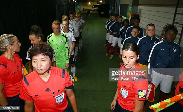 The team of Germany and of France line up before the FIFA U20 Women's World Cup 2014 semi final match between Germany and France at Olympic Stadium...