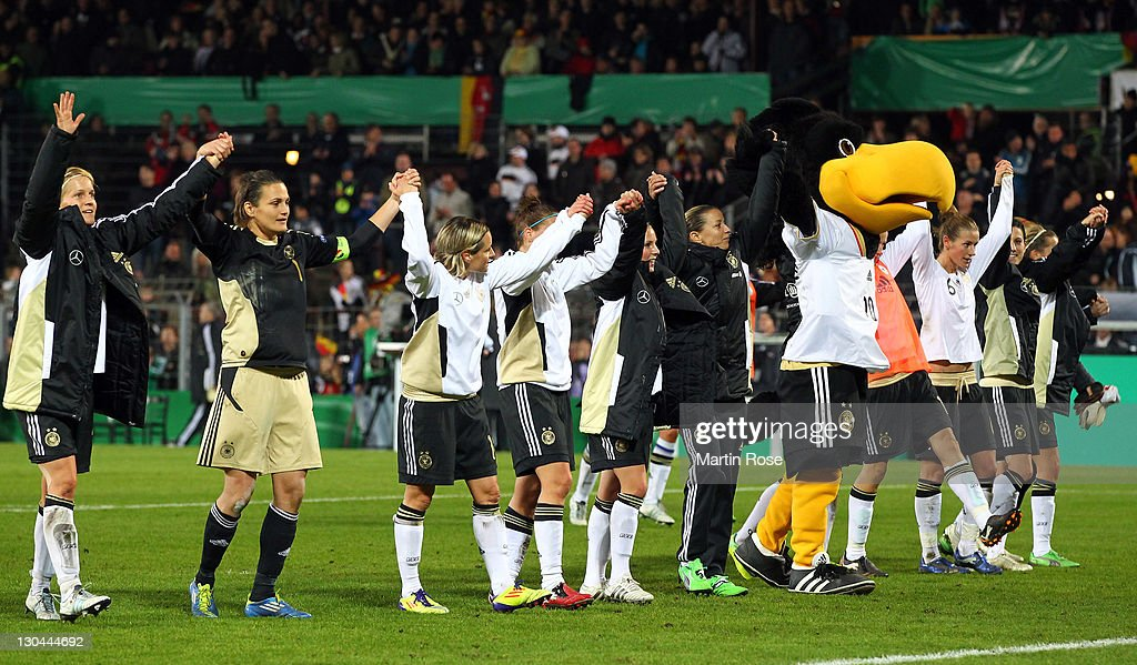 The team of Germany celebrate after the Women's International friendly match between Germany and Sweden on October 26, 2011 in Hamburg, Germany.