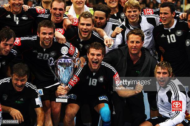 The team of Germany celebrate after winning the Supercup 2009 game between Germany and Denmark at the TUI Arena on November 1 2009 in Hanover Germany