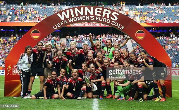The team of Germany celebrate after winning the UEFA Women's EURO 2013 final match between Germany and Norway at Friends Arena on July 28 2013 in...