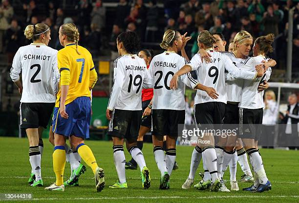 The team of Germany celebrate their opening goal during the Women's International friendly match between Germany and Sweden on October 26, 2011 in...