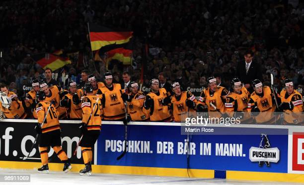 The team of Germany celebrate their team's opening goal during the IIHF World Championship group D match between USA and Germany at Veltins Arena on...