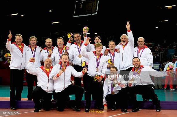 The team of Germany celebrates after winning the bronze in the Men's Sitting Volleyball competition on day 10 of the London 2012 Paralympic Games at...