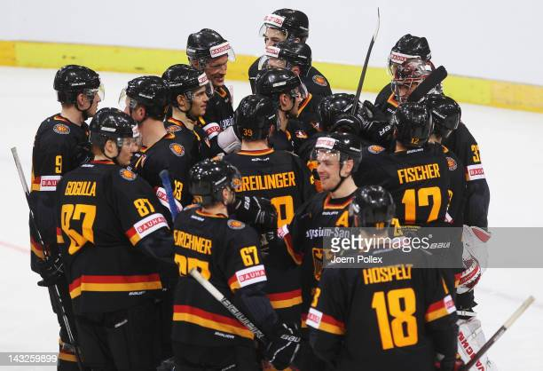 The team of Germany celebrates after winning the international friendly icehockey match between Germany and Denmark at TUI Arena on April 22, 2012 in...