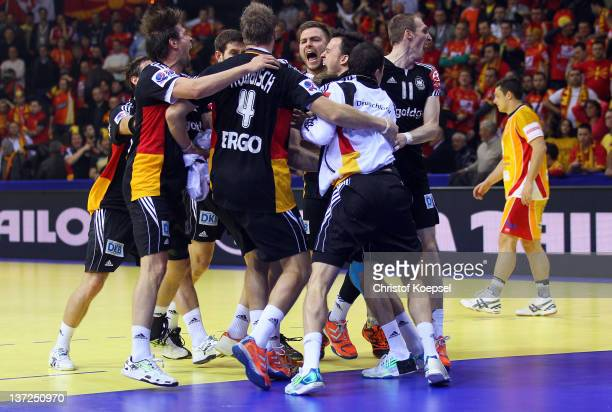 The team of Germany celebrates the 24-23 victory after the Men's European Handball Championship group B match between Macedonia and Germany at Cair...
