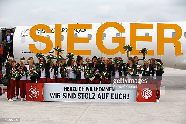The team of Germany celebrates winning the UEFA Women's EURO 2013 during the arrival at Cargo Center South at Frankfurt Airport on July 29, 2013 in...