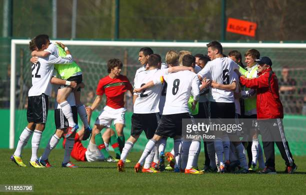The team of Germany celebrfate after winning the U17 Men's Elite Round match between Germany and Portugal on March 25, 2012 in Bremen, Germany.