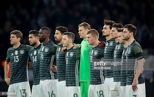 The team of Germany hold a minute of silence prior to the International Friendly match between Germany and England at Olympiastadion on March 26 2016...
