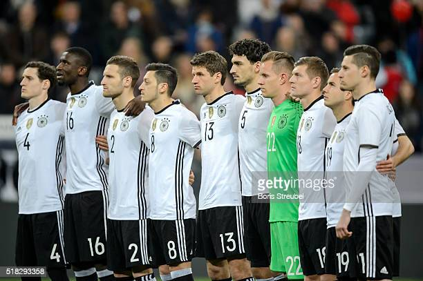 The team of Germany holds a minute of silence prior to the International Friendly match between Germany and Italy at Allianz Arena on March 29 2016...