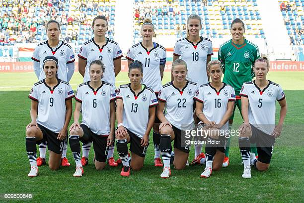 The team of Germany lines up for photographers prior to the UEFA Women's Euro 2017 Qualifier between Hungary and Germany at Gyirmot Stadium on...
