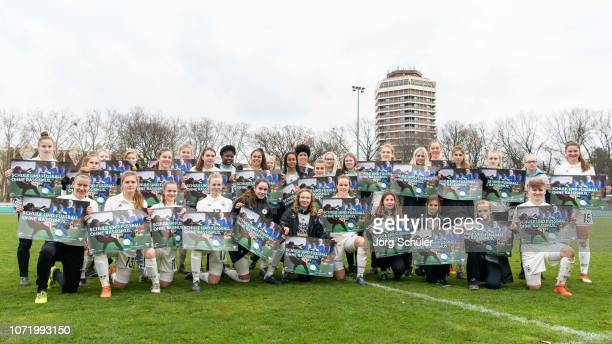 The team of Germany poses for a photo with banners saying School and soccer without racism after the U17 Girl's international friendly match between...