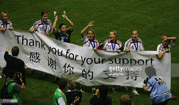 The team of Germany shows a banner after winning the Women's World Cup 2007 Final match between Brazil and Germany at the Shanghai Hongkou Football...