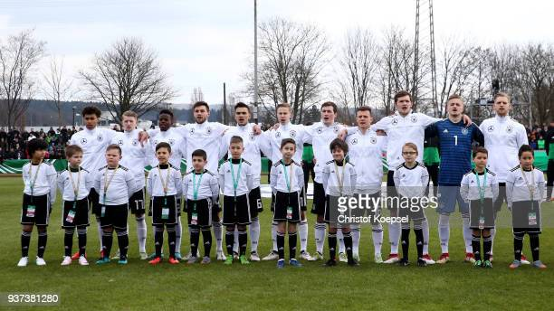 The team of Germany stands for the national anthem prior to the UEFA Under19 European Championship Qualifier match between Germany and Norway at...