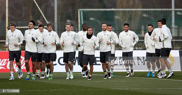 The team of Germany warm up during a Germany training session ahead of the international friendly match against England at Stadion am Wurfplatz on...
