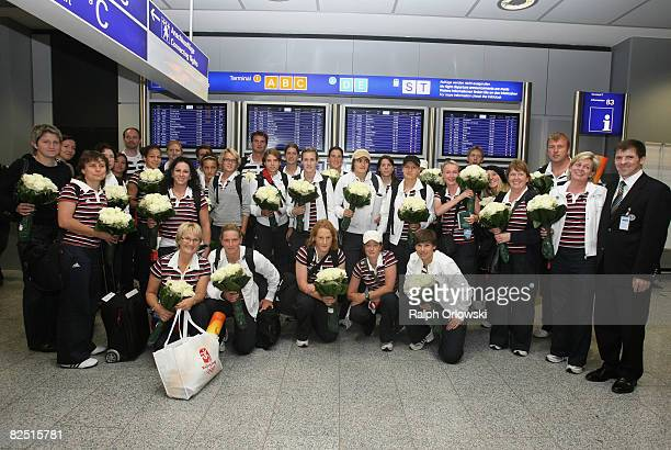 The team of Germany's women football national team lined up for a team photo after they arrived from the 2008 Beijing Olympic Games at Frankfurt...