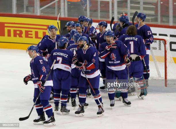 The team of Great Britain celebrate the victory over Slovenia during the 2018 IIHF Ice Hockey World Championship Division I Group A match between...