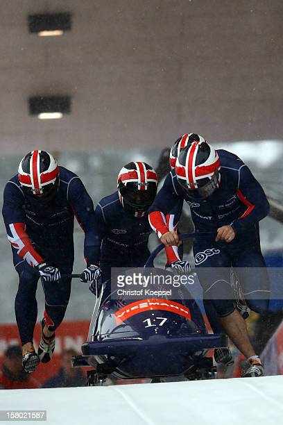 The team of GreatBritain with John James Jackson Stuart Benson Bruce Tasker and Andre Matthews sprints during the four men's bob competition during...