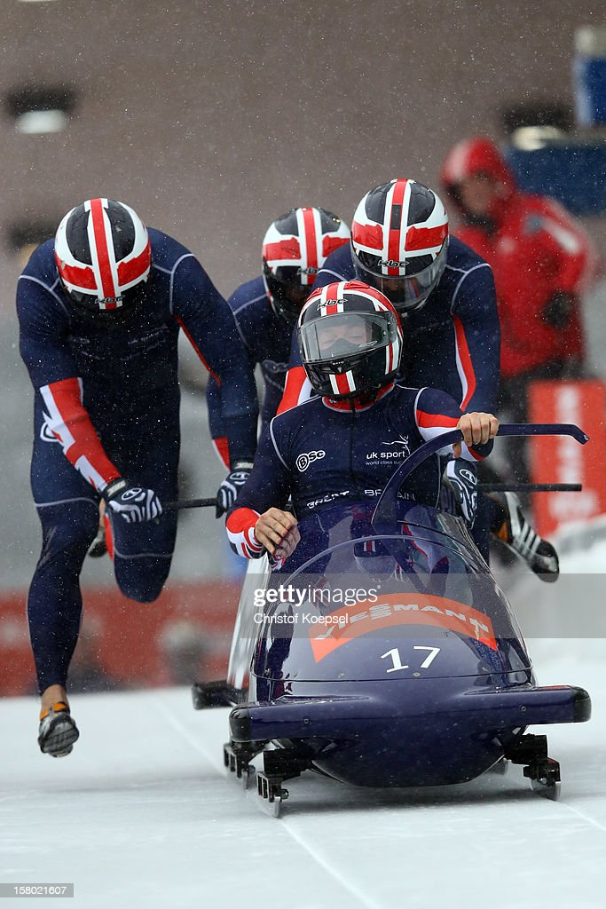 The team of Great-Britain with John James Jackson, Stuart Benson, Bruce Tasker and Andre Matthews sprints during the four men's bob competition during the FIBT Bob & Skeleton World Cup at Bobbahn Winterberg on December 9, 2012 in Winterberg, Germany.