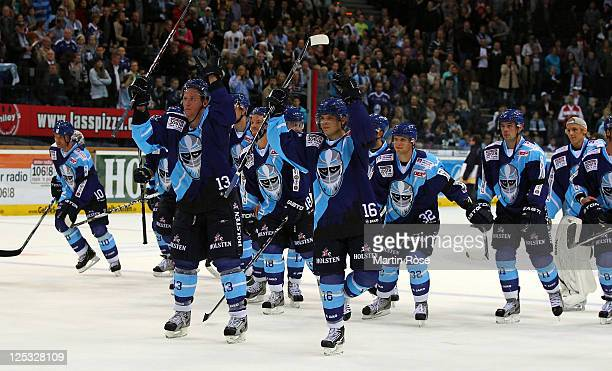 The team of Hamburg celebrate after the DEL match between Hamburg Freezers and Adler Mannheim at the O2 World Arena on September 16, 2011 in Hamburg,...