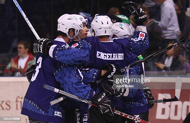 The team of Hamburg celebrates after Colin Murphy of Hamburg scored his team's first goal during the DEL match between Hamburg Freezers and...