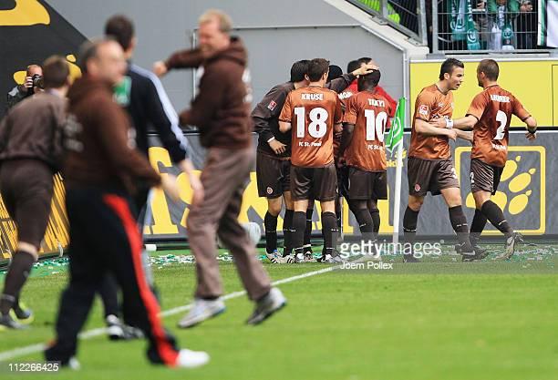 The team of Hamburg celebrates after Matthias Lehman of St. Pauli scored his team's second goal during the Bundesliga match between VfL Wolfsburg and...