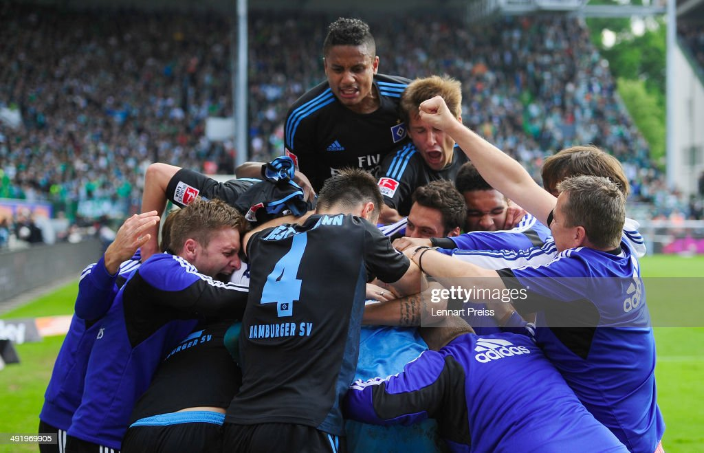 The team of Hamburg celebrates after the Bundesliga Playoff Second Leg match between SpVgg Greuther Fuerth and Hamburger SV at Trolli-Arena on May 18, 2014 in Fuerth, Germany.
