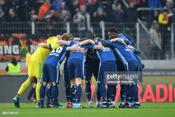 The team of Hamburg forms a circle prior to the Bundesliga match between FC Augsburg and Hamburger SV at WWKArena on January 13 2018 in Augsburg...